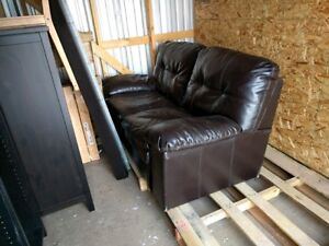 Black leather love seat