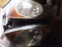 1 PAIR OF NISSAN NOTE HEADLAMPS