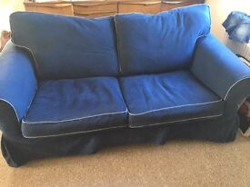Clean Sofá, 2 seater, upholstered in Jeans kind of fabric.