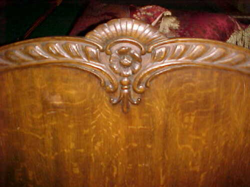 ANTIQUE TIGER OAK SETTEE WITH LIONS HEADS