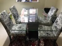Glass Top dining table with solid dark brown wood base. To seat 4 People. Used
