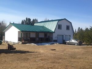 COUNTRY HOME ON 3.7 ACRES IN FIELD