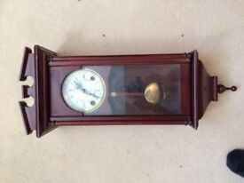Grandfather Wood Wall Clock with Chime. Pendulum wind up. 2 ft high x 9 inch wide.