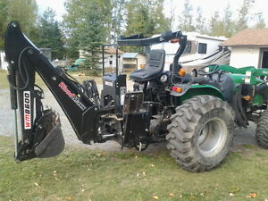 tractor , backhoe, snow blade, 6 ft rottotiller, tire chains