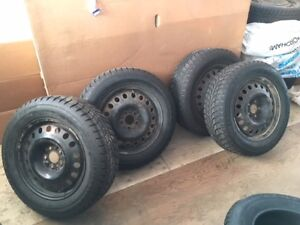 4 Studded Winter tires on rims 225/65/17