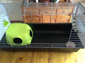 Indoor large rabbit hutch together with food bowl and chew toy - good condition - useful in winter