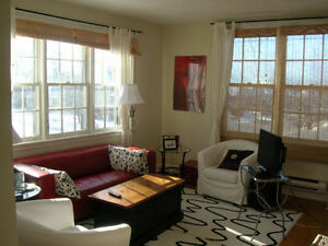 Large 1-1/2 bedroom available now