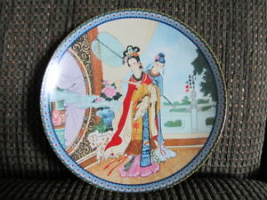 Two Chinese Collector Plates  $19.00 each