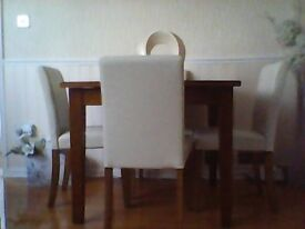 real solid oak square dinning table and four cream leather chairs