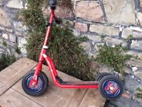 Child's red scooter