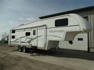 2003 Titanium 5th wheel RV with bunks.