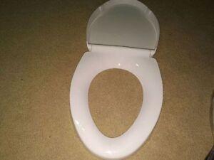 Toilet seats - white elongated - new Kitchener / Waterloo Kitchener Area image 1