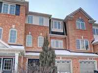 Freehold Townhouse with professionally finished walkout basement