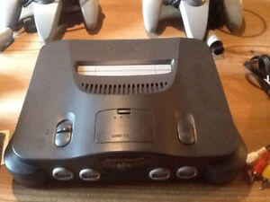 Nintendo 64 console with 3 controllers and 4 games