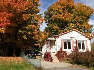Petite maison avec garage , Pointe du Lac