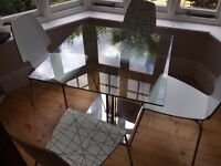 Glass topped John Lewis dining table and Ikea chairs