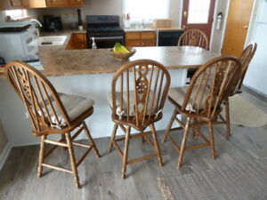 Matching set of oak swivel bar/island height chairs