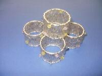 napkin rings (4) gold in colour