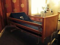ELECTRICALLY OPERATED NURSING CARE BED