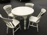 Solid Pine table and 4 chairs,