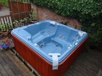 Sundance hot tub with accessories