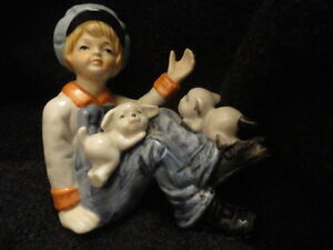 Vintage Porcelain Figurine Boy playing with puppies