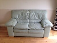 Pale leather natuzzi suite ( 2 seater sofa and matching chair)