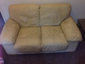 Cream two-seater leather sofa