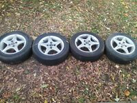 Four tires P185/60R/14 with OZ racing rims