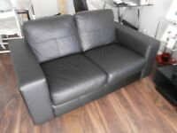 Two-seater leather sofa and matching single armchair (black)