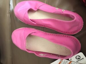 Girls Crocs size 5 brand new with tags were 45.00