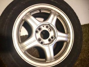 4 tires WITH RIMS 185/60R14