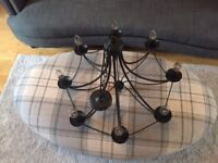 Wrought iron chandelier with eight candle lights