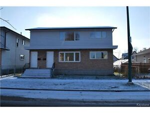 2BR duplex house available July 1.
