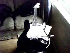 Black Fender Squire Strat and Amp