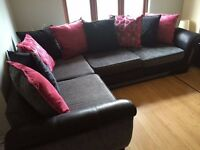Grey/ black fabric corner sofa with black and pink changeable pillow back cushions