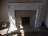 Adam style fire surround with marble base and inlay.