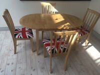 Oval solid oak dining set (extendable table and 4 upholstered chairs with union jack covers) as new