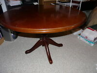Solid cherry round table with pedestal