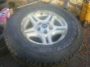 four Ford truck 17 inch rims with decent tires