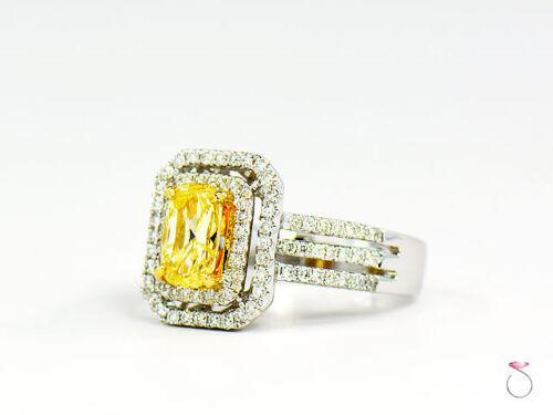 Natural Fancy Intense Yellow Diamond Ring, 1.02 ct. 18K White Gold 1.40 CTW. GIA 4