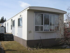 GREAT PRICE on this mobile home in South Hill in Calgary!!