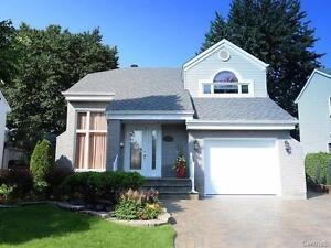 Luxueux cottage clé en main à Fabreville + 150,000$ investi