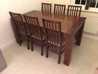 Extendable dining table with 6 chairs (can seat up to 8)