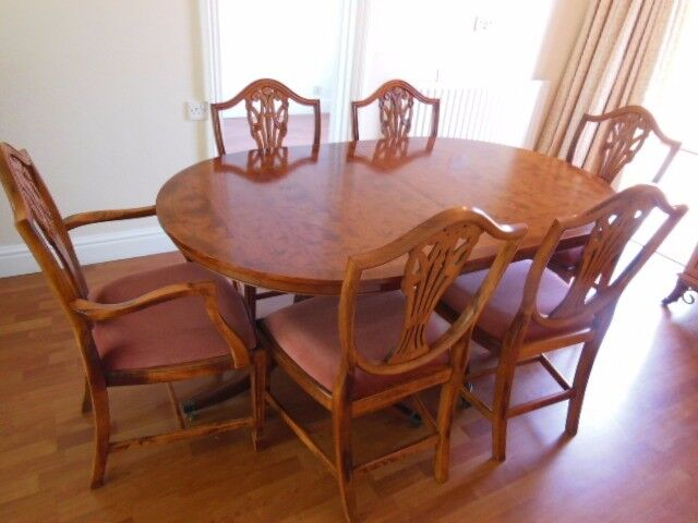 YEW DINING ROOM TABLE AND 6 CHAIRS