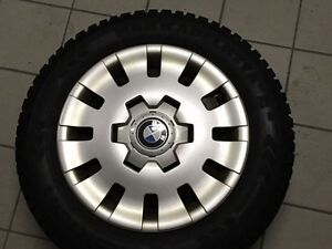 195/65/15 Nokia Rims with Hubcaps and tires winter West Island Greater Montréal image 1