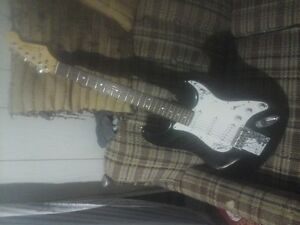 Academy strat and Traynor amp 160 flat