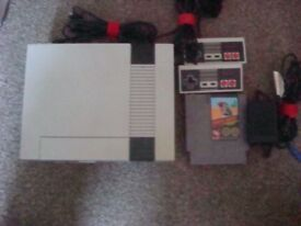 original nintendo nes 2 controllers and a game swap for mini nes or other retro gaming console