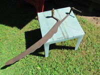 Antique hay saw and hay fork