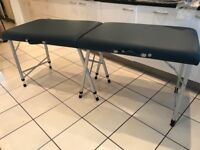 Massage bed in good condition with head extension and towelling covers